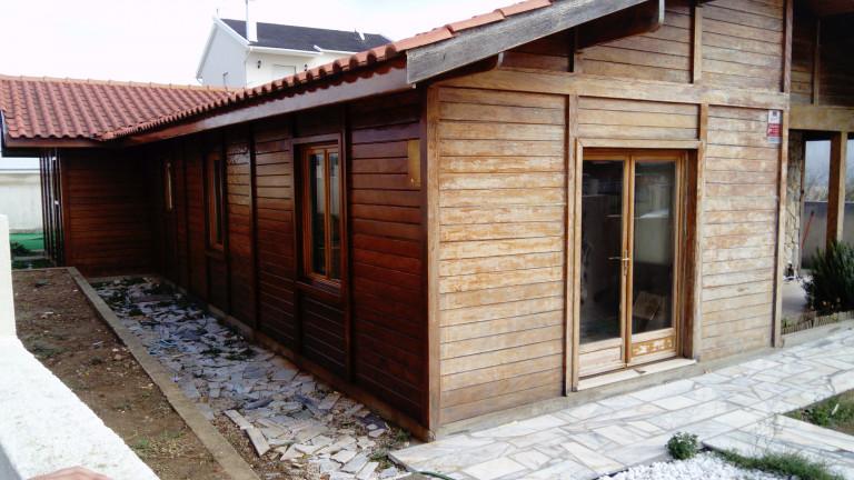 portfolio 6/38  - Pintura de casa de madeira